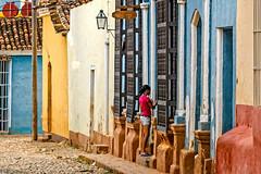 colours (Brian D. Tucker) Tags: girl bars cuba january cobblestones tiles colonialarchitecture trinidad verticality 2016 d610 colonialcity briandtucker january2016