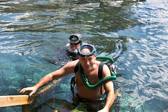 Two Double hose divers. (Vintage Scuba) Tags: woman man men silver fight women gun mask smooth knife diving rubber double hose diver beavertail fins wetsuit tanks spear regulator