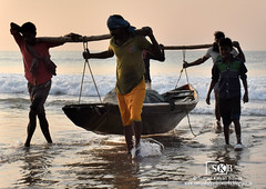 Moment of returning after fishing (Suman Kalyan Biswas) Tags: morning sea india beach silhouette photography boat fishermen outdoor portraiture daybreak touristspot puri profession bayofbengal livelihood abstractportrait puribeach walksoflife odisha puriseabeach  fishermenreturninghome autoremovedfrom1to5faves portraitureinmotion indianpopularbeach