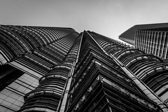 towers (likeslimes) Tags: city travel bw white holiday black architecture asia pentax south petronas towers east malaysia kl klcc suria 1224 smcda likeslimes