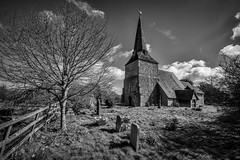 St Mary's Church, Sevington (James Waghorn) Tags: flowers england blackandwhite tree heritage church clouds fence kent spring nikon shadows medieval gravestone sigma1020f456 d7100 topazclarity silverefexpro2