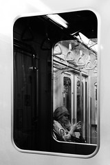 (cherco) Tags: blackandwhite woman window hat japan mystery composition ventana tokyo pretty metro frame reflejo sombrero framing japon tokio composicion enmarcado canon60d