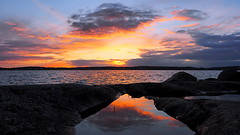 Seaside Evening (Jens Haggren) Tags: sunset sea sky seascape water clouds reflections evening seaside rocks colours sweden olympus vrmd em1