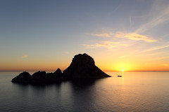 Sunset on Es Vedra in Ibiza island (Travelbusy.com) Tags: ocean travel light sunset sea summer vacation sky orange sun holiday seascape black color tourism beach nature water beautiful beauty sunshine silhouette horizontal skyline backlight sunrise dark landscape island islands evening back twilight spain travels holidays colorful warm europe paradise mediterranean seascapes view dusk background space horizon perspective warmth location panoramic ibiza beaches destination backlit copyspace copy idyllic vacations touristic balearic destinations esvedra islasbaleares balear