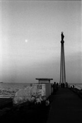 Moonrise at sunset (adrian.sadlier) Tags: film 35mm mono moonrise artdeco stellamaris bullisland dollymount ilfordfp4plus125 nikonf5 bathingshelter