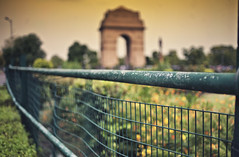 Silent Intropsection... (The Canon Fanboy) Tags: city india history architecture clouds asia bokeh dusk delhi explore greenery newdelhi indiagate goldenglow bokehlicious beyondbokeh