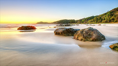 Nobbys Beach / Sunrise (Young Ko) Tags: blue sky sun seascape art beach nature yellow rock sunrise landscape interesting nikon perfect rocks colorful flickr awesome atmosphere harmony minimalism firstlight garie nobbysbeach portmacquariensw