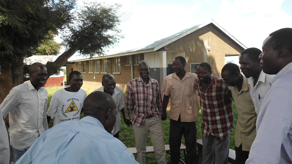 Men attending a GSP group session in Namukora sub-county in Kitgum district