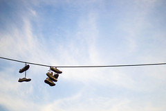Shoes on the sky (pierrezahphotography) Tags: blue light sky white beautiful clouds photography shoe shoes shadows athens greece powerlines plaka dangling tossing select hanged