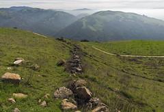 Ancient Wall (LeftCoastKenny) Tags: trees grass clouds fence haze rocks hills sierravistatrail sierravistaopenspacepreserve