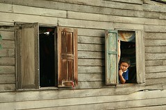 boy in a window (the foreign photographer - ฝรั่งถ่) Tags: boy house window portraits canon thailand wooden kiss bangkok shutters khlong bangkhen thanon 400d