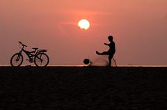 Kick off (1/4th) Tags: morning sea sun india beach sports bicycle silhouette marina sunrise ball football sand nikon kickoff nikkor marinabeach chennai tamilnadu cwc  nikon80200mmf28d 80200mmf28dnew  d7000 chennaiweekendclickers  cwc491