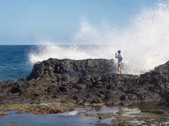 hope that's a waterproof cell phone (dolanh) Tags: hawaii maui spray nakaleleblowhole kahekilihighway