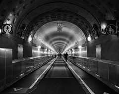 Tunnel (BoN.cz) Tags: tunnel hamburg blackwhite 100 100faves bw olympus urban architecture city town night people walk passage germany german lights street black white sidewalk road underground signs beautiful dark passageway underpass subway tube nice