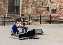 IMG_2719-2 (Dmitriy Feldman) Tags: street city travel italy musician music playing milan castle tourism town europe guitar citadel entrance entertainment bastion castellosforzesco