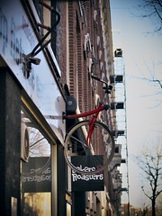 How can I get on that bicycle? : ) (Long Sleeper) Tags: street trees sky holland reflection building tree amsterdam bicycle sign shop architecture store thenetherlands dmcgx1 lumixg425mmf17asph