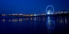 night reflections (sussexscorpio) Tags: sea water wheel architecture night canon reflections sussex pier seaside twilight brighton colours waterfront outdoor dusk hove seafront eastsussex brightonpier palacepier brightonandhove canon60d brightoneye brightonwheel