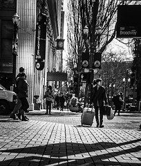 It's Better To Travel (TMimages PDX) Tags: road street city people urban blackandwhite monochrome buildings portland geotagged photography photo image streetphotography streetscene sidewalk photograph pedestrians pacificnorthwest avenue vignette fineartphotography iphoneography