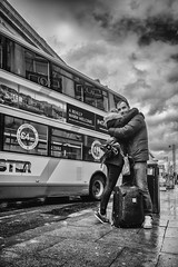 A really warm welcome (tootdood) Tags: road street blackandwhite bus clouds manchester hug couple warm candid stormy farewell oldham welcome really greeting fromthehip omnibus streetcandid canon70d