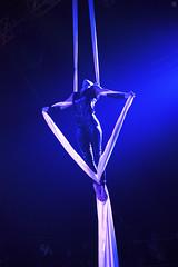 Aerialist Inna Astvatsaturova (Jul Chitay) Tags: show blue light woman white girl sport club dark fly power circus arts aerial spotlight gymnastics acrobatics aerials acrobatic silks aerialist aerialsilks aerialarts