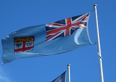 One of many flags (spelio) Tags: blue sky flags april canberra flagpole act 2016