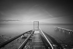 The Access (Maximecreative) Tags: door longexposure mist lake mountains alps clouds switzerland ramp leman f28 select 14mm samyang leefilters bigstopper sw150