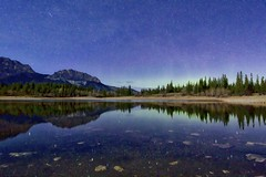 Moonlight at Middle Lake (John Andersen (JPAndersen images)) Tags: trees lake mountains night clouds reflections aurora meteor bowvalleypark