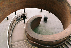 Inspiring spiral (Victor W Adams) Tags: street leica uk england man color colour film geometric stairs composition newcastle walking spiral geometry walk candid streetphotography pedestrian scan staircase walkway fibonacci ellipse scanned vista geometrical analogue curve streetscape overhead birdseyeview newcastleupontyne goldenspiral poundland agfavista200 leicar4s ruleofcomposition