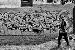 An Audience of One (Pauls-Pictures) Tags: camera city friends people urban blackandwhite streetart art monochrome wall lens photography one graffiti fuji audience rehearsal circus candid watching sydney australian photographers balls australia lovers fujifilm juggling juggler standard performer streetphotos practise compactcamera streetphotographer streetpics twoscompany streetphotograhy achromatic xt1 streetpictures fxlens mirrorlesscamera australianstreetphotographers 35nmf14lens