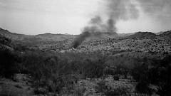 Desert Fire (Shot by Newman) Tags: bw southwest nature 35mm fire daylight smoke brush ilforddelta400 rockformations mojavedesert shotbynewman