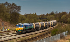 Looking very pretty, GBRf Individually liveried Class 66/7 No. 66711 at Clay Cross on 21st April 2016, en route from Tinsley to Bardon Hill. (kevaruka) Tags: railroad light england sun color colour green art colors sunshine yellow composition train canon geotagged outdoors photography eos spring europe flickr day colours afternoon cross outdoor derbyshire vivid rail railway sunny trains front 66 class telephoto clay page april vehicle 5d british network freight springtime lightroom mk3 2016 freightliner ef100400 railfreight f4556l gbrf 66711 tupton 5d3 5diii 21042016