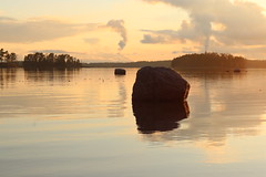 smoke mirrors and a still seafront (jtunkelo) Tags: sunset sea sunlight beach finland helsinki waterfront balticsea seafront stillness 2016 kallahti kallvik
