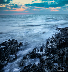 Tide (Safarii) Tags: longexposure light sunset sea sky sun seascape motion wet water rock evening coast rocks waves wave devon jagged woolacombe