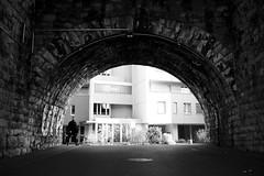 Im Viadukt (maekke) Tags: street bridge urban bw man brick architecture switzerland noiretblanc streetphotography sbb symmetry fujifilm zrich ch kreis5 2015 viadukt x100t