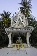 Nathaniel Moseley-20140207-20140207-_DSC0653-Vientiane Wander One-Vientiane Wander One (FinalDoom) Tags: trees statue temple laos bushes vientiane offerings vientianecapital