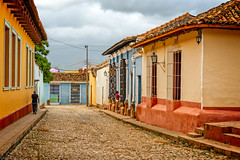 colonial architecture (Brian D. Tucker) Tags: girl bars cuba january cobblestones tiles colonialarchitecture trinidad verticality 2016 d610 colonialcity briandtucker january2016