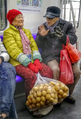 Convince Me_colorful AhYi (Charles R. Yang) Tags: china train shopping subway ride shanghai metro oldman oldlady phonecamera convincing vivophone smartphonephotography