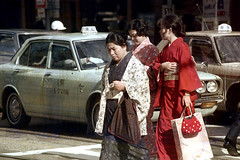 30-531 (ndpa / s. lundeen, archivist) Tags: street city winter people woman color fall cars film car japan 30 35mm bag japanese women kyoto candid cab taxi nick citylife streetphotography streetlife taxis spots purse kimono bags 1970s crosswalk damaged cabs 1972 distressed youngwoman kimonos dewolf localpeople youngwomen honshu discolored heatdamage traditionalclothing damagednegative nickdewolf photographbynickdewolf reel30