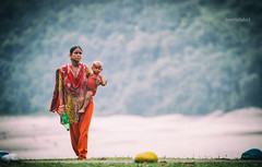 Carrying her world (Numbplug) Tags: street travel family trees mountains rural canon mom outdoors asia child horizon mother streetphotography son best hills bond banladesh