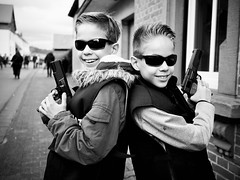 Bad Boys (B-Lichter) Tags: carnival boys monochrome sunglasses pen children fun blackwhite cool twins gun police olympus siblings disguise zuiko 1718 epl7