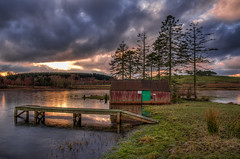 old boat house (poach01) Tags: trees sun lake reflection ice nature water grass clouds sunrise reeds landscape reflecting boat fishing pond nikon scenery colours outdoor jetty shed platform sigma sunsets hills shore fields loch sunrays picturesque hdr frozenpond hawick scottishborders fishinghut oldboathouse