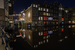 Red-light reflections (McQuaide Photography) Tags: old city longexposure nightphotography windows winter light urban house holland reflection window water netherlands dutch amsterdam architecture night zeiss photoshop vintage outside licht lowlight europe nacht outdoor sony traditional tripod capital nederland wideangle ramen fullframe alpha huis residence 16mm residential redlightdistrict oud stad authentic raam rld manfrotto noordholland gracht lightroom huizen canalhouse wideanglelens capitalcity 1635mm northholland a7ii grachtenpand groothoek variotessar mirrorless sonyzeiss mcquaidephotography ilce7m2