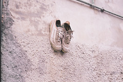 Pair of shoes (simoncini.nicola) Tags: life light italy sunlight white plant film wall architecture analog 35mm lens dead real photography 50mm idea weird is still scary dof shot cloudy kodak bokeh geometry iso400 bleach creepy adventure explore pot 400 buy pottery overexposed weirdo walls borgo marche bleached strano touched retina megapixels offagna ultramax whiten overesposed iiic revolutional