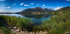 Lago di Annone (Stefan Liebermann) Tags: travel light summer sky italy panorama sun mountain lake mountains alps reflection nature water beautiful grass clouds landscape schweiz see wasser sommer hill wolken panoramic noon ufer reflexions sonne idyllic spiegelung lecco schilf mittag reflexionen sonnenschein