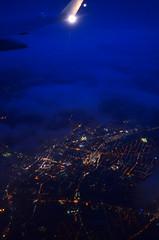 evening flight (Wolfgang Binder) Tags: sky window night clouds zeiss plane lights evening nikon village view flight wing windowseat distagon distagont2825 d7000