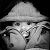 Two beautiful eyes (Hans Dethmers) Tags: baby monochrome eyes fuji coat ogen jas speen teat capuchon hansdethmers
