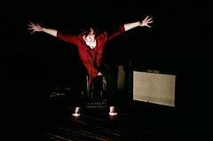 Eliza Brown (tylersullivan618) Tags: shadow red woman chicago color art film female digital dark photography holga lomo lomography hands experimental artist arms pentax vibrant being wide microphones performance amp human fender photograph sound perform performanceart mic sounds flak mics gestures intuit soundart musictheater elizabrown movemnet elomography armswide chicagoart chicagoartists thecenterforintuitiveandoutsiderart tylersullivan pentaxk500 tylersullivanphotography cellopiece flakperformanceseries chicagoperformers