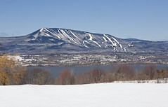 Distant Skiis (sarajdsign) Tags: city trees winter mountain snow ski landscape spring orleans skiing quebec isle cananda slopes