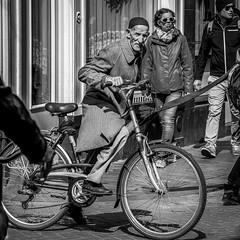 A true Amsterdammer cycles (nagajohn) Tags: people blackandwhite streets holland netherlands monochrome amsterdam photography nikon fotografie outdoor candid nederland streetphotography streetlife streetscene moment mokum beautifulpeople onthestreet amsterdammers straten straatfotografie opstraat mooiemensen straatfotograaf d5200 nagajohn johnkwee