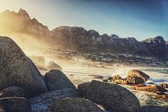 Shine a Light (FlavioSarescia) Tags: ocean travel light sea summer sun sunlight mountain mountains beach nature water sunshine rock sunrise landscape southafrica rocks ray shine capetown rays sunrays